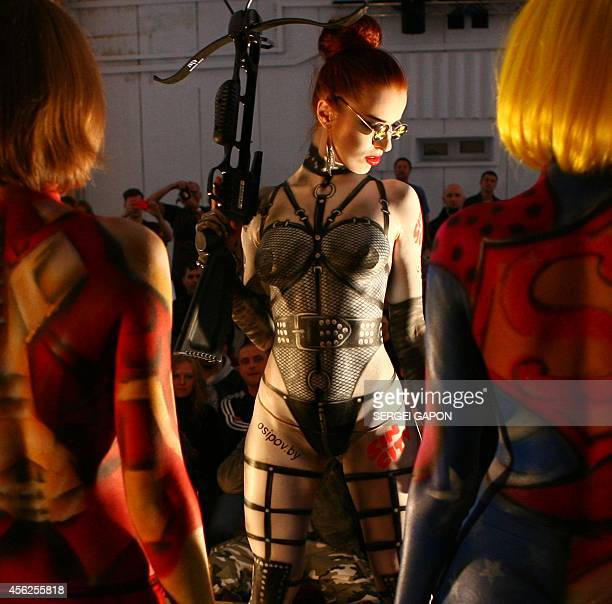 Models display body paint creations at the International tattoo and bodyart festival in Minsk on September 28 2014 AFP PHOTO / SERGEI GAPON