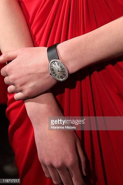 Models display Cartier jewelry and watches as they arrive at the reopening of the Cartier flagship store on June 9 2011 in Sydney Australia