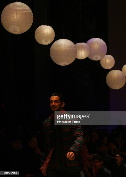 Models display creation by designer Arjun Khanna on the opening day of the Lakme Fashion Week at the NCPA