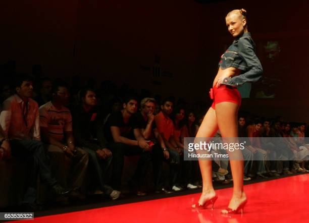 Models display creation by designer Levis on the opening day of the Lakme Fashion Week at the NCPA