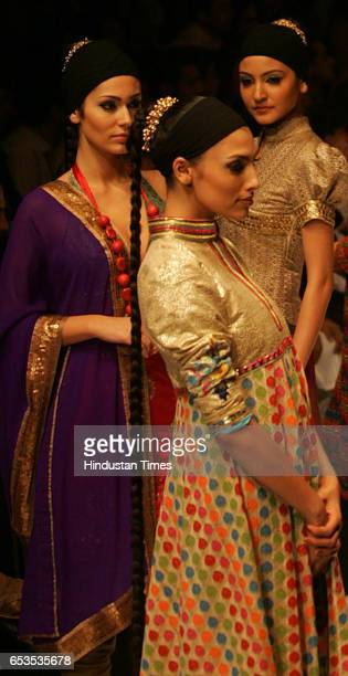 Models display creation by designer Vikram Phadnis on the opening day of the Lakme Fashion Week at the NCPA