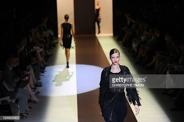 Models display creations as part of Gucci springsummer 2011 readytowear collection on September 22 2010 during the Women's fashion week in Milan AFP...