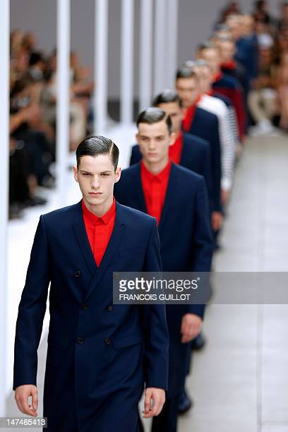 Models display creations by Belgian designer Kris Van Assche for the label Dior during the men's springsummer 2013 fashion collection show on June 30...