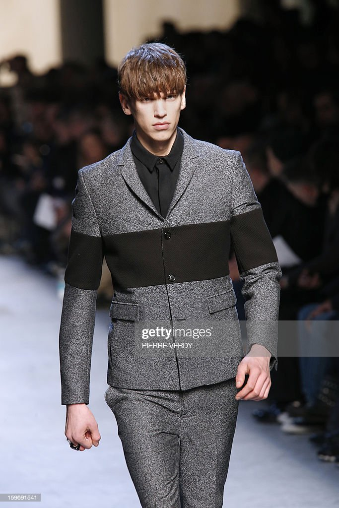 Models display creations by Belgian designer Kris Van Assche on January 18, 2013 during his men's fall-winter 2013-2014 fashion collection show during the fashion week in Paris. AFP PHOTO / PIERRE VERDY