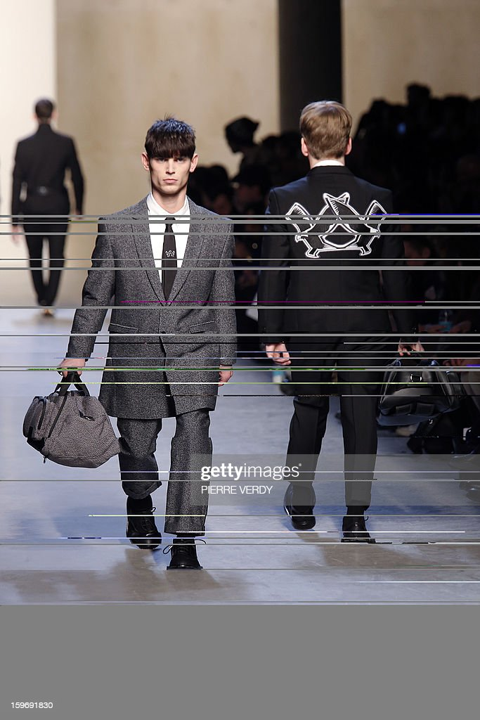 Models display creations by Belgian designer Kris Van Assche on January 18, 2013 during his men's fall-winter 2013-2014 fashion collection show during the fashion week in Paris.