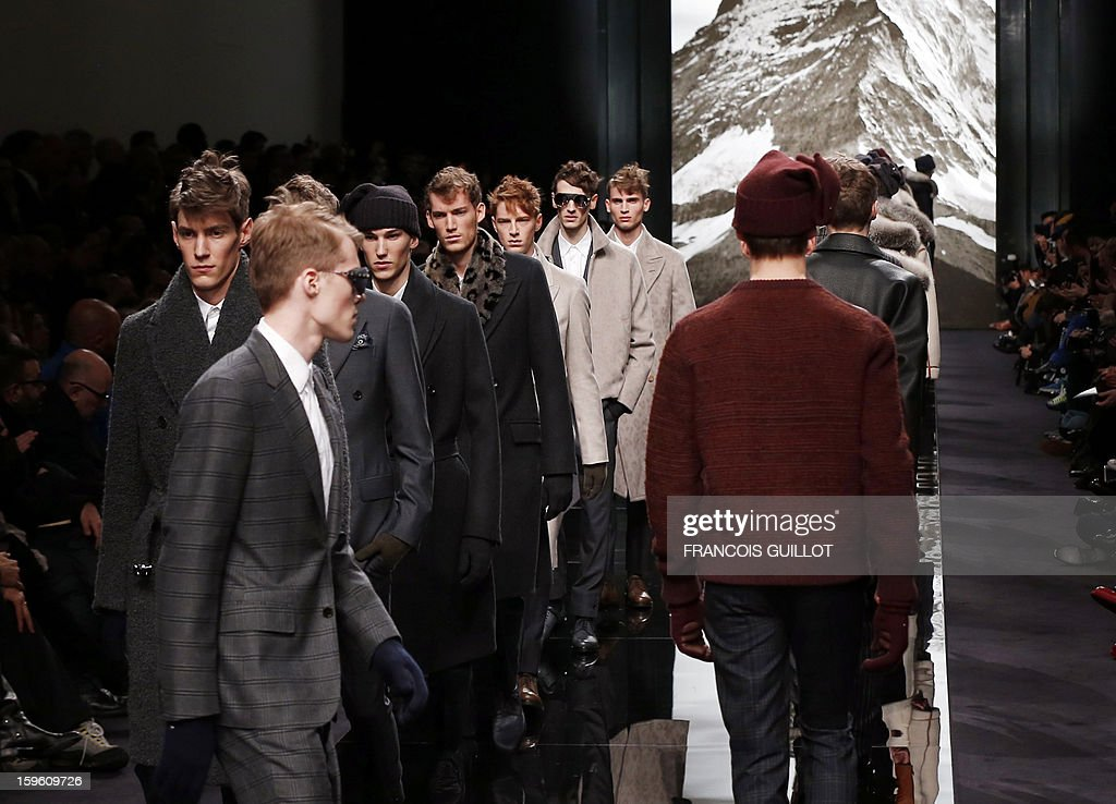 Models display creations by British designer Kim Jones for Louis Vuitton during the men's Fall-Winter 2013-2014 collection show on January 17, 2013 during the Men's fashion week in Paris.