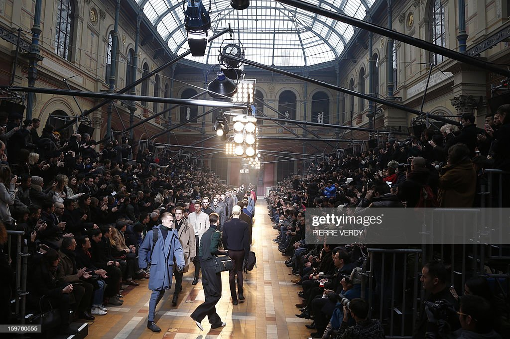 Models display creations by Dutch designer Lucas Ossendrijver and Moroccan-born Israeli designer Alber Elbaz for the label Lanvin during the men's Fall-Winter 2013-2014 collection show on January 20, 2013 as part of the Men's fashion week in Paris.