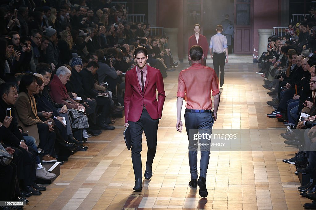 Models display creations by Dutch designer Lucas Ossendrijver and Moroccan-born Israeli designer Alber Elbaz for the label Lanvin during the men's Fall-Winter 2013-2014 collection show on January 20, 2013 as part of the Men's fashion week in Paris. AFP PHOTO PIERRE VERDY