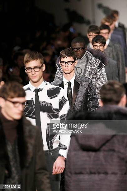 Models display creations by Dutch designers Viktor Horsting and Rolf Snoeren for the label Victor and Rolf during the men's FallWinter 20132014...