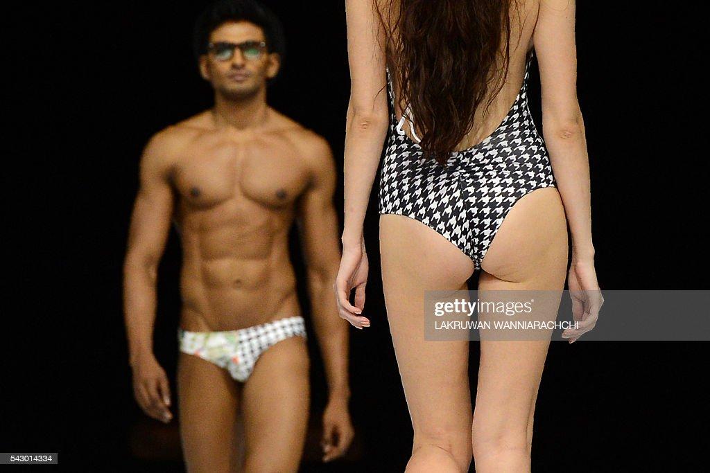 Models' display creations by fashion designer Prasad Bidapa at the Swim Week Colombo fashion show at the Port of Colombo on June 25, 2016. Swim week Colombo fashion show includes designers from Sri Lanka, Australia, India, Britain and the United States. / AFP / LAKRUWAN