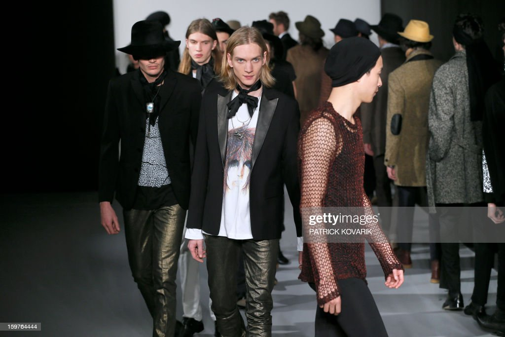 Models display creations by French designer Agnes B on January 20, 2013 during the men's fall-winter 2013-2014 fashion week in Paris.