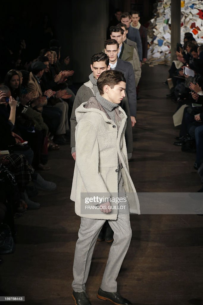 Models display creations by French designers Mathieu de Menonville and Remi de Laquintane for the label Melinda Gloss during the men's Fall-Winter 2013-2014 collection show on January 20, 2013 as part of the Men's fashion week in Paris.