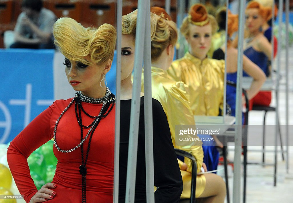 Models display creations by hairdressing and make up students during the international beauty festival of young designers 'Nevskie berega' (Neva River banks) in Russia's second city of Saint Petersburg on February 21, 2014.