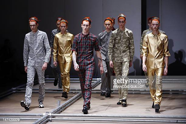 Models display creations by Japanese designer Rei Kawakubo for the Comme des Garcons fashion house during the men's springsummer 2013 fashion...