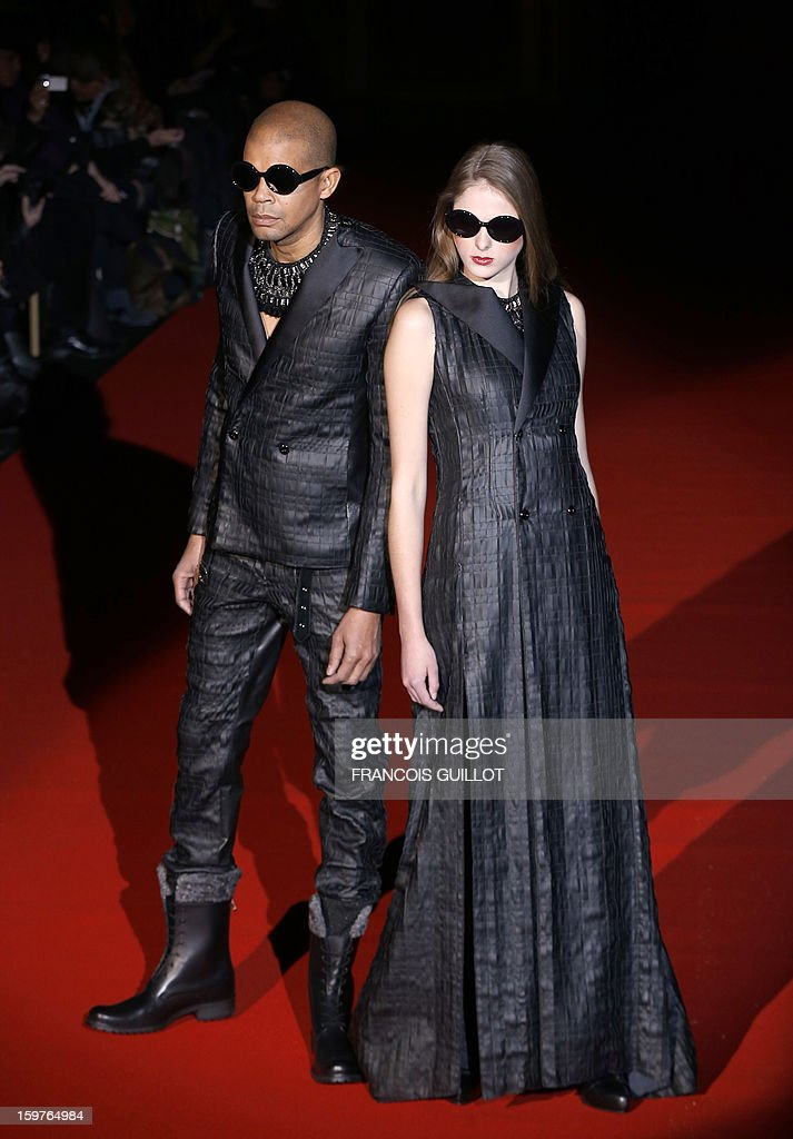 Models display creations by Japanese designer Rynshu on January 20, 2013 during the men's fall-winter 2013-2014 fashion week in Paris.