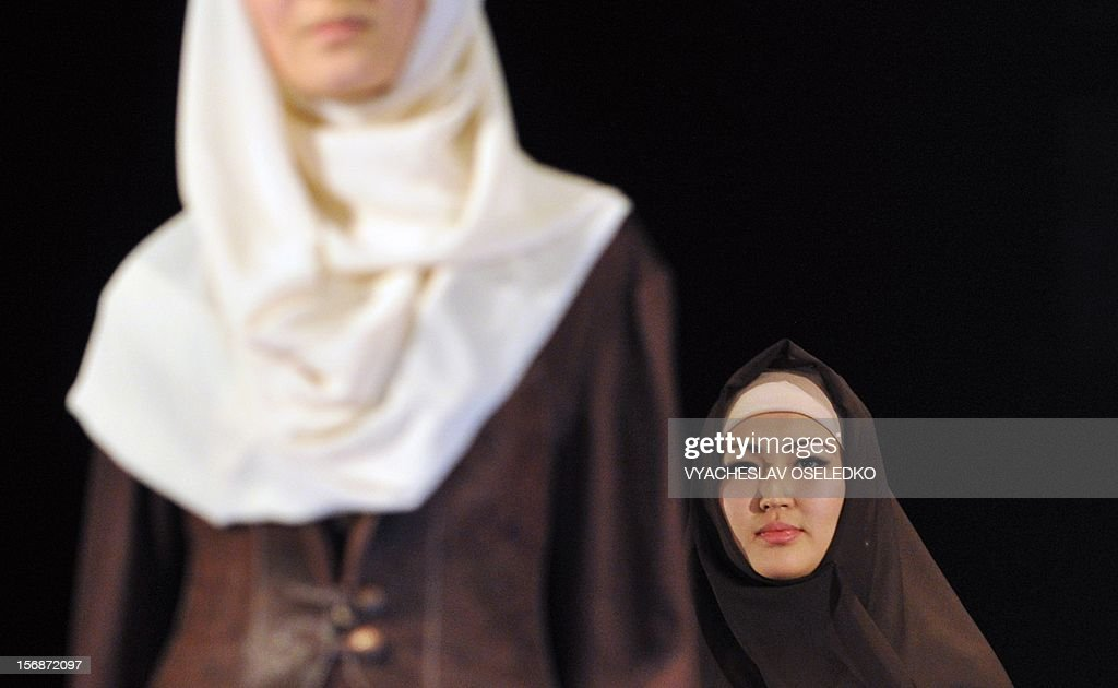 Models display creations by Kyrgyz designer Bakyt Beshbayev during a Muslim fashion in the Kyrgyzstan's capital Bishkek, late on November 22, 2012.
