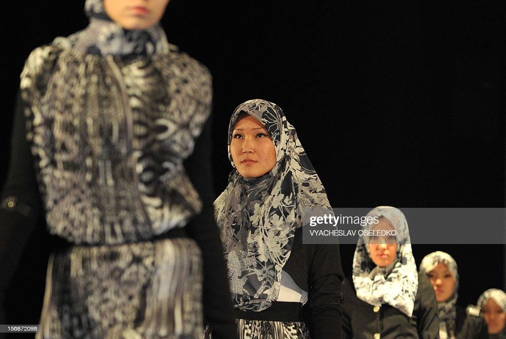 Models display creations by Kyrgyz designer Usen Berdibayev during a Muslim fashion in the Kyrgyzstan's capital Bishkek, late on November 22, 2012.