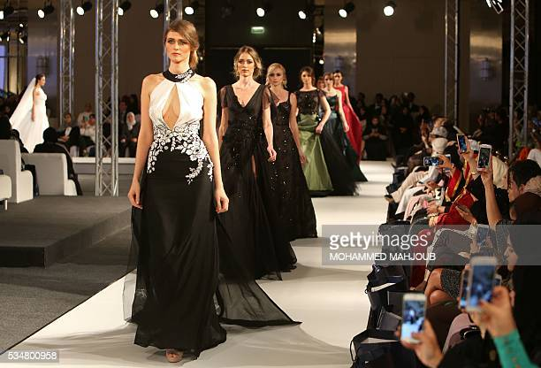Models display creations by Lebanese designer Abed Mahfouz during the launch of the 4th edition of the Ladies a La Mode fashion show on May 27 in the...