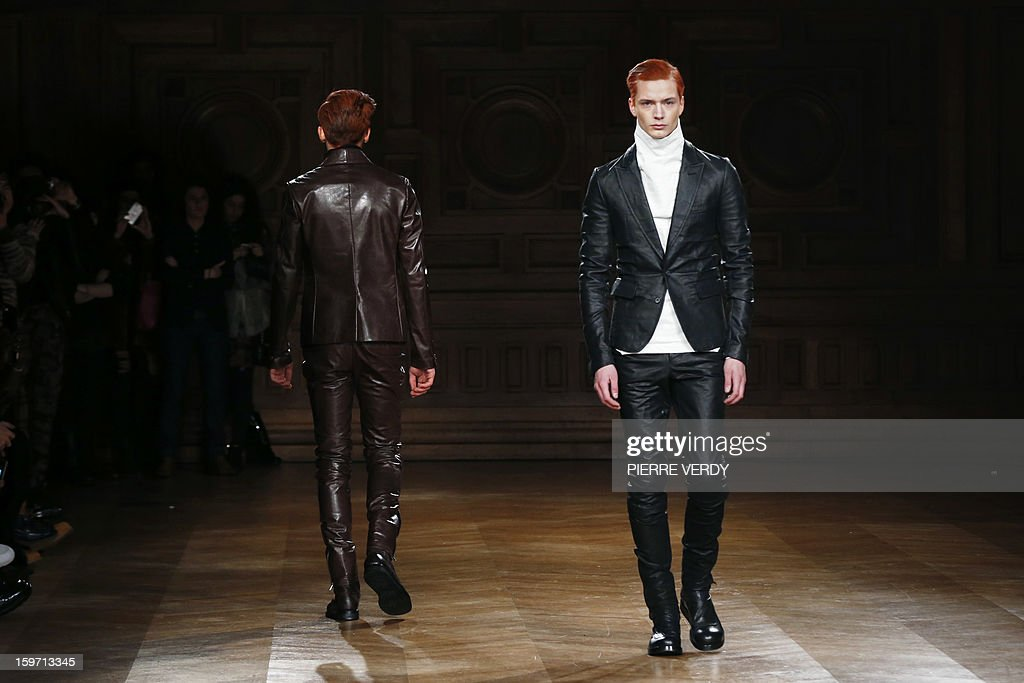 Models display creations by South Korea designer Songzio on January 19, 2013 during the men's fall-winter 2013-2014 fashion week in Paris.