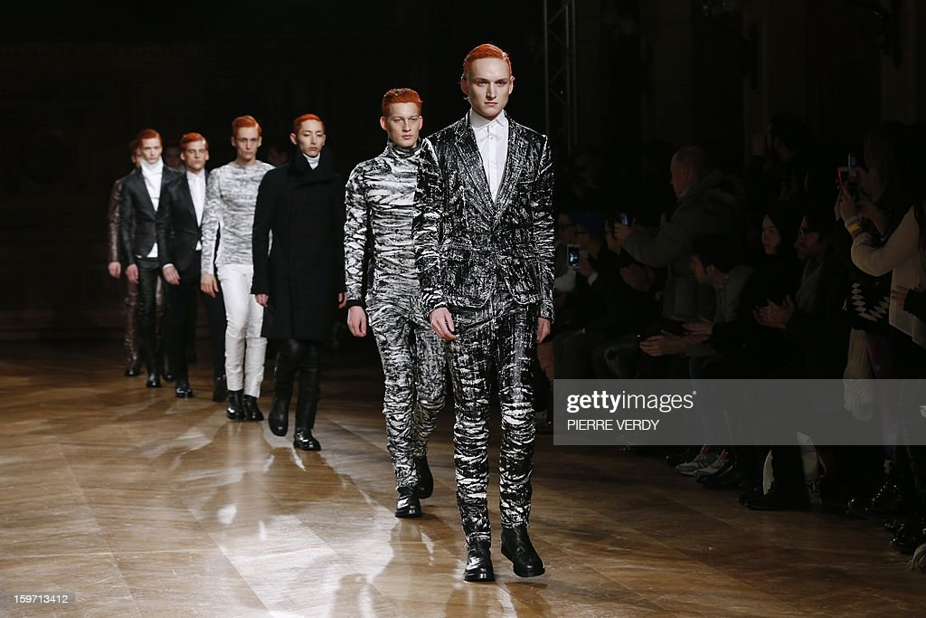 Models display creations by South Korean designer Songzio on January 19, 2013 during the men's fall-winter 2013-2014 fashion week in Paris.