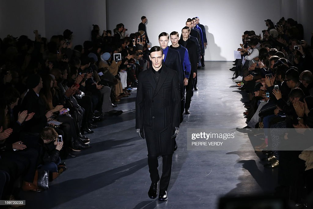 Models display creations by South Korean designer Young Mi Woo during the Wooyoungmi men's Fall-Winter 2013-2014 collection show on January 19, 2013 as part of the Men's fashion week in Paris. AFP PHOTO PIERRE VERDY
