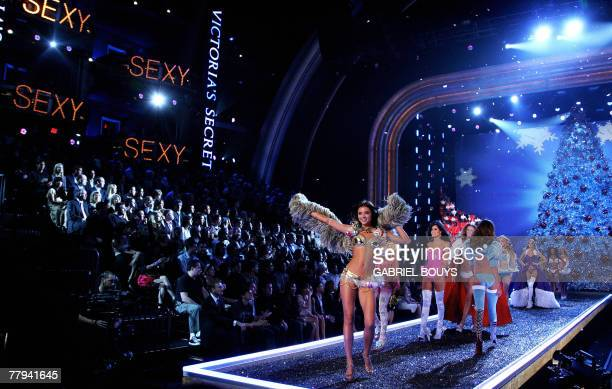 Models display outfits during the Victoria's Secret fashion show at the Kodak Theatre in Hollywood California 15 November 2007 AFP PHOTO GABRIEL BOUYS