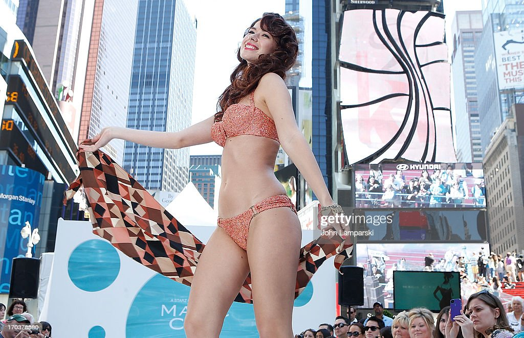 Models display retro bathing suits and lounge wear curated by Carol Ramsey at the 'Magic City' Season 2 premiere celebration in Times Square on June 12, 2013 in New York City.