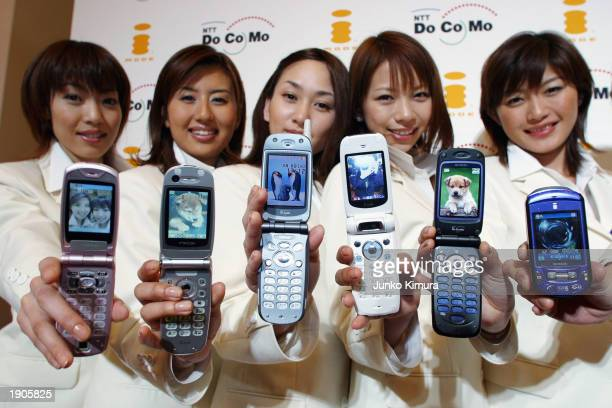 Models display the newly introduced NTT DoCoMo's 505i series imode mobile phones at a press conference on April 8 2003 in Tokyo Japan the mobile...