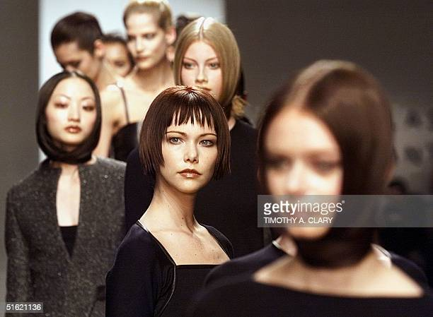 Models display various hairstyles and outfits during the showing of the Douglas Hannant 1999 Fall/Winter collection at Bryant Park in New York 16...