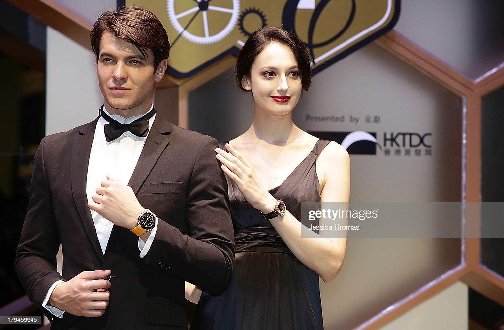 Models displays watches during a watch parade at the Hong Kong Watch And Clock Fair on September 4, 2013 in Hong Kong, Hong Kong.