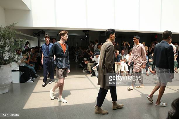 Models do a final run through on the runway at the Deveaux fashion presentation during New York Fashion Week Men's S/S 2017 at Spring Studios on July...