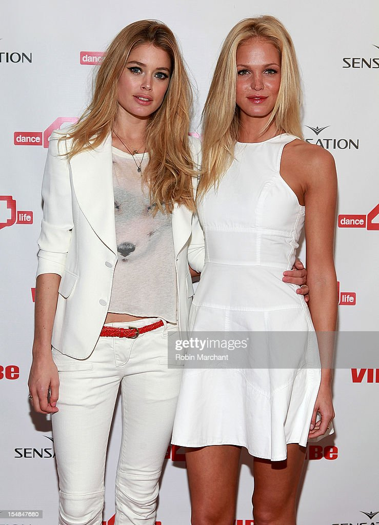 Models <a gi-track='captionPersonalityLinkClicked' href=/galleries/search?phrase=Doutzen+Kroes&family=editorial&specificpeople=859655 ng-click='$event.stopPropagation()'>Doutzen Kroes</a> (L) and Erin Heatherton attend dance4life cocktail party at Milk Studios on October 27, 2012 in New York City.