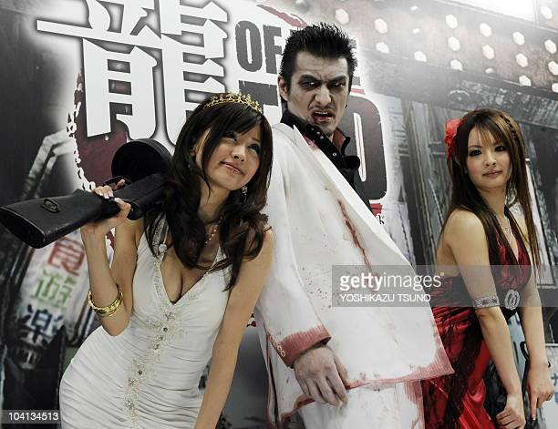 Models dressed as yakuza videogame characters for the promotion of new software at the Tokyo Game Show in Chiba city suburban Tokyo on September 16...