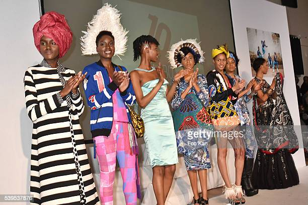 Models dressed by different designers walk the runway during the finale of 'Labo International' 10th Edition African Ethnic and Sapeurs Fashion Show...