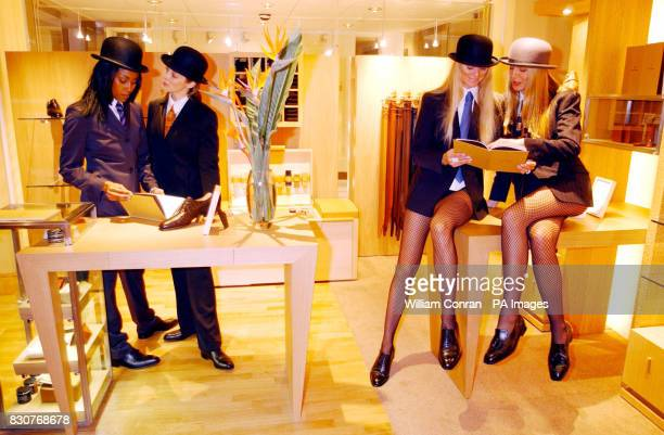 Models dressed in city gent outfits pose during the launch of the new John Lobb shoe shop at the newlyrefurbished courtyard of the Royal Exchange in...