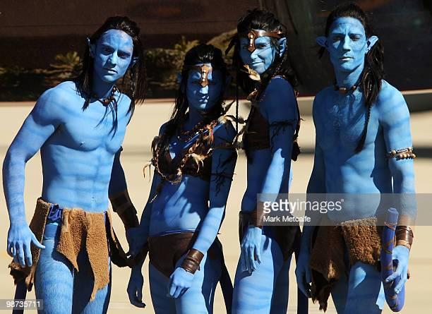 Models dressed up as characters from the film 'Avatar' pose during the launch of 'AVATAR' Bluray and DVD at Sydney Domestic Airport on April 29 2010...
