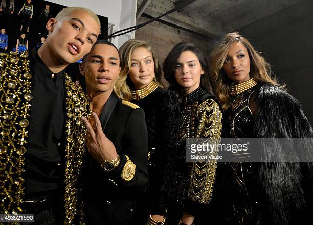 Models Dudley O'Shaughnessy Gigi Hadid Kendall Jenner and Jourdan Dunn pose with the Creative Director of Balmain Olivier Rousteing at the BALMAIN X...