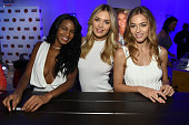 Models Ebonee Davis Megan Williams and Caroline Kelley pose together at the Sports Illustrated Swimsuit 2016 Swim City at the Altman Building on...