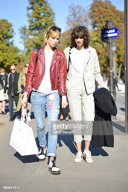 Models Edie Campbell and Mica Arganaraz leave after the Chloe show at the Grand Palais during Paris Fashion Week SS16 on October 1 2015 in Paris...