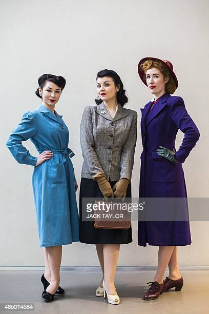 Models Ella LewisCollins Jennifer Siggs and Sadie Doherty wear 1940s style clothing as they pose for the photographer during a photo call for the...