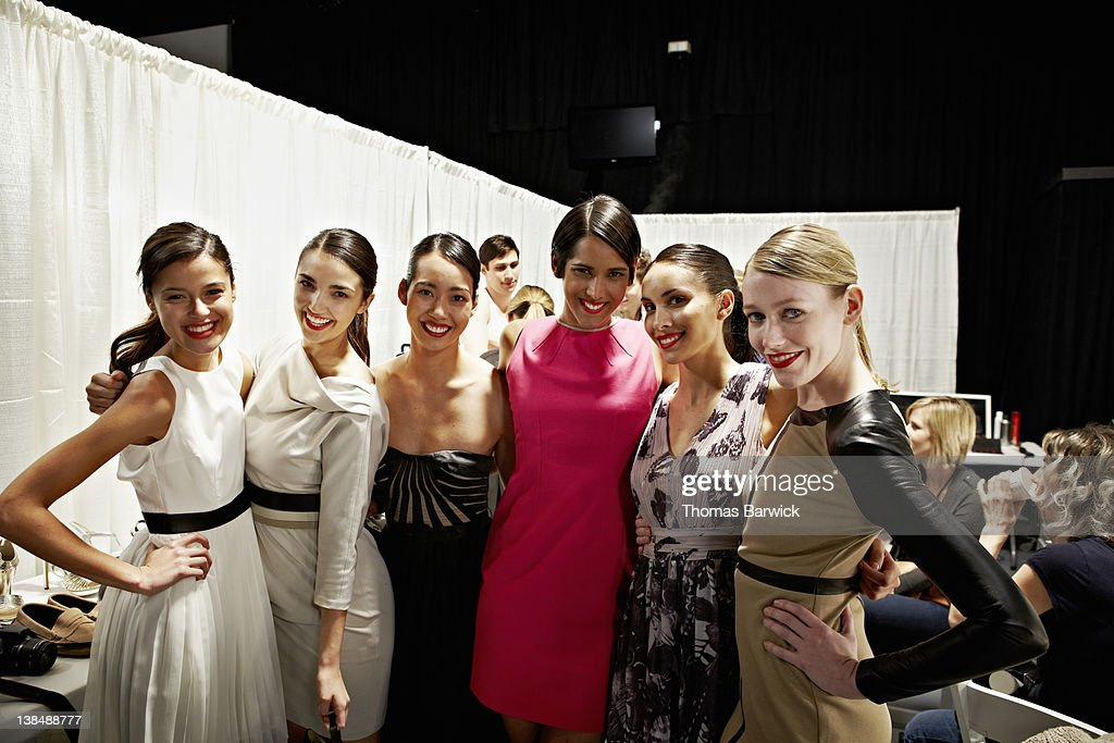 Models embracing backstage after fashion show : Stock Photo