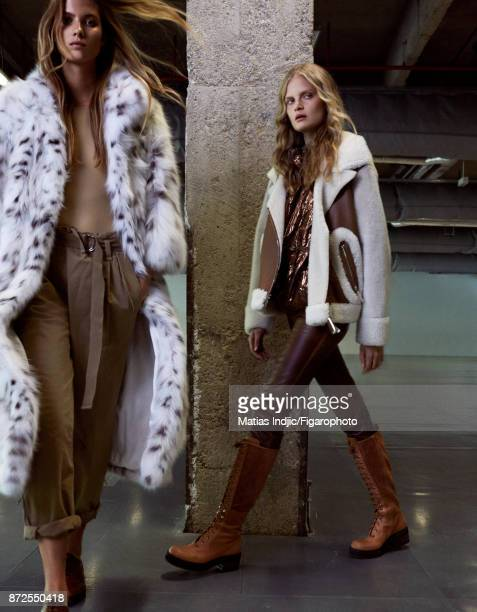 Models pose at a fashion shoot for Madame Figaro on September 19 2017 in Paris France Left Coat body pants shoes Right Jacket sweater pants boots...