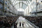 Models fake a demonstation as they present creations for Chanel 2015 Spring/Summer readytowear collection fashion show on September 30 2014 at the...