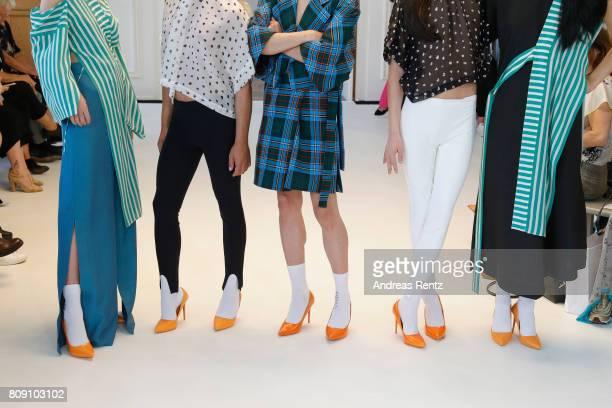 Models fashion detail pose at the Antonia Goy Defile during 'Der Berliner Mode Salon' Spring/Summer 2018 at Kronprinzenpalais on July 5 2017 in...