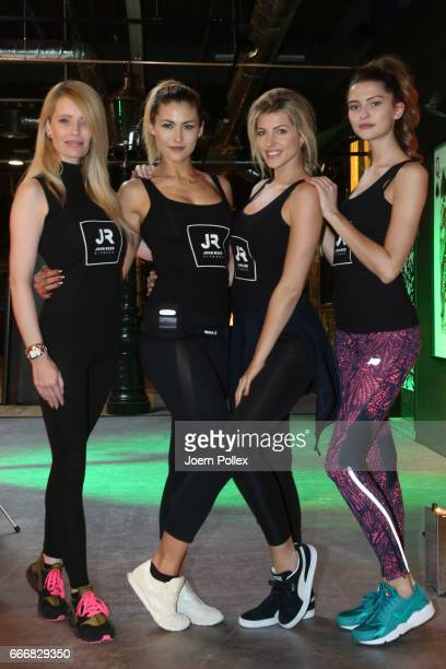 Models Fata Hasanovic and Fiona Erdmann Sarah Nowak and Mirja Du Mont pose during the opening of John Reed Fitness Music Club on April 10 2017 in...