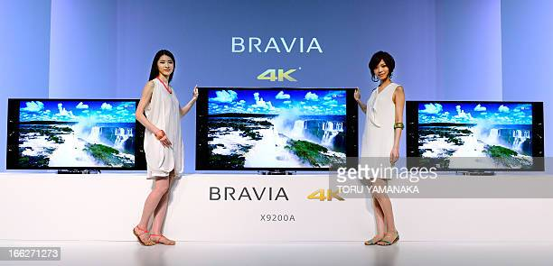 Models for Japan's electronics giant Sony show off new 4K ultra high definition LCD TV 'Bravia X9200A' during a press conference in Tokyo on April 11...