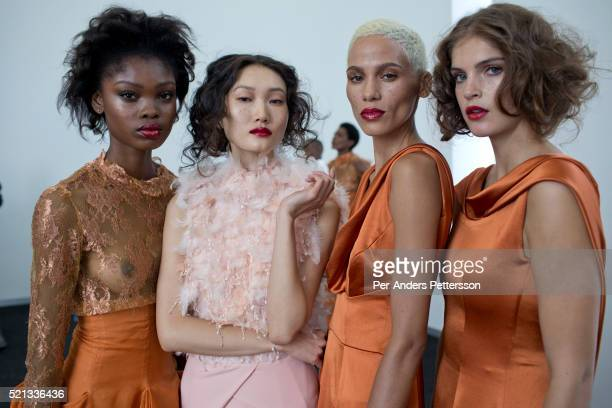 Models for the South African designer David Tlale wait backstage before showing his latest collection at Mercedes Benz Africa fashion week Africa on...