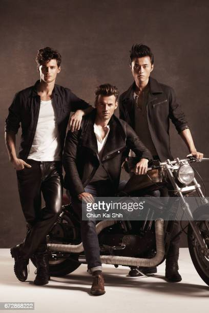 Models Garrett Neff Alex Lundqvist and Zhao Lei are photographed for August Man on August 7 2002 in New York City COVER IMAGE