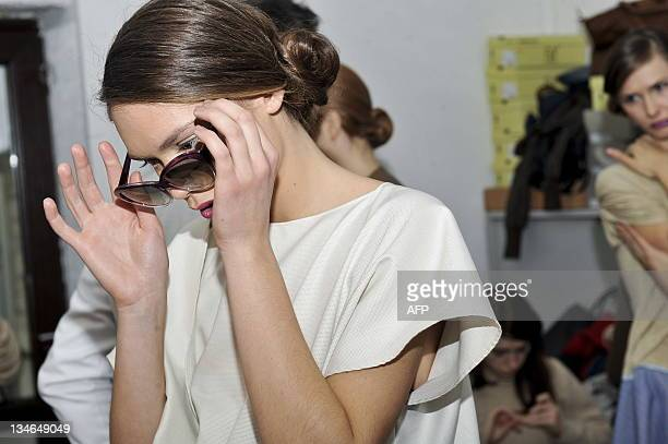 Models get readu backstage to present creations made by Kosovo designer Krenare Rugova during a fashion show 'Harmony of Filingree' in Pristina on...