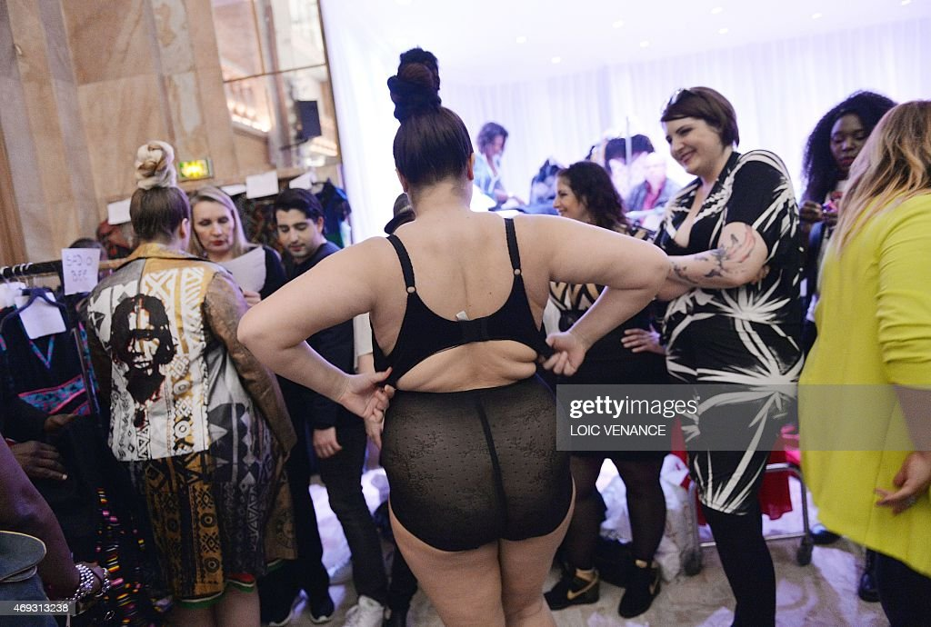 Models gets ready for a show, part of the third edition of the Pulp Fashion Week Paris on April 11, 2015 in Paris. The Pulp Fashion Week event aims at representing society's diverse spectrum of beauty with plus-size models, that runs through April 11-12. AFP PHOTO / LOIC VENANCE